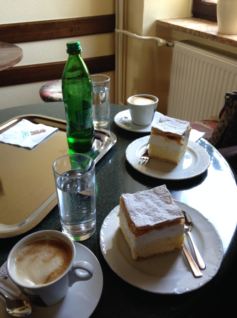 Cream cake and cappuccinos-- the ultimate afternoon snack.